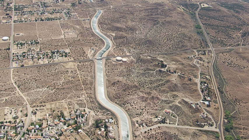 HD stock footage aerial video flyby rural desert homes around the California Aqueduct in Palmdale, California Aerial Stock Footage   CAP_006_006