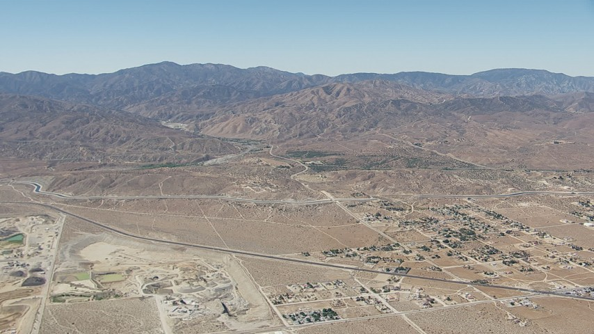 HD stock footage aerial video of neighborhoods near the California Aqueduct and mountains in Palmdale, California Aerial Stock Footage | CAP_006_010