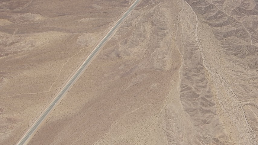 HD stock footage aerial video of bird's eye view of a highway through open desert in San Bernardino County, California Aerial Stock Footage | CAP_006_012