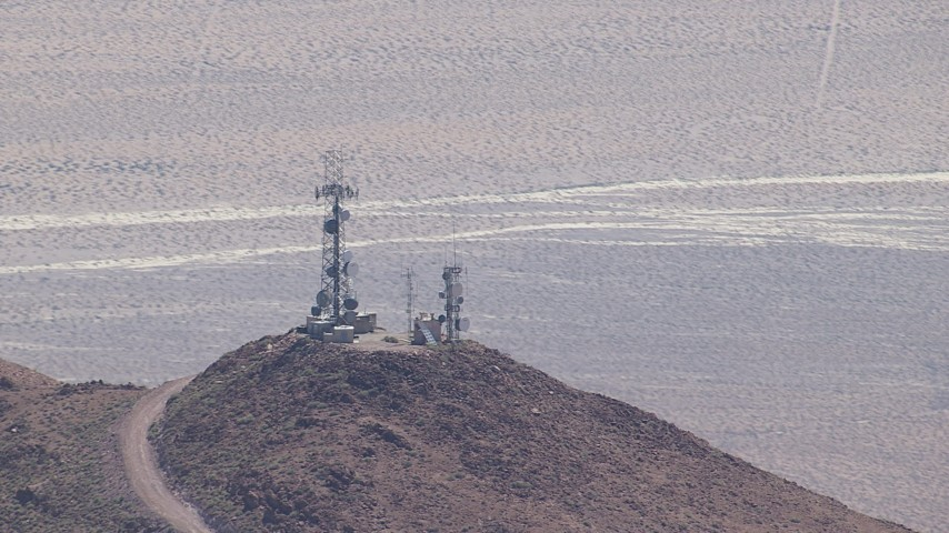 HD stock footage aerial video of mountaintop radio towers in the Mojave Desert, San Bernardino County, California Aerial Stock Footage | CAP_006_014