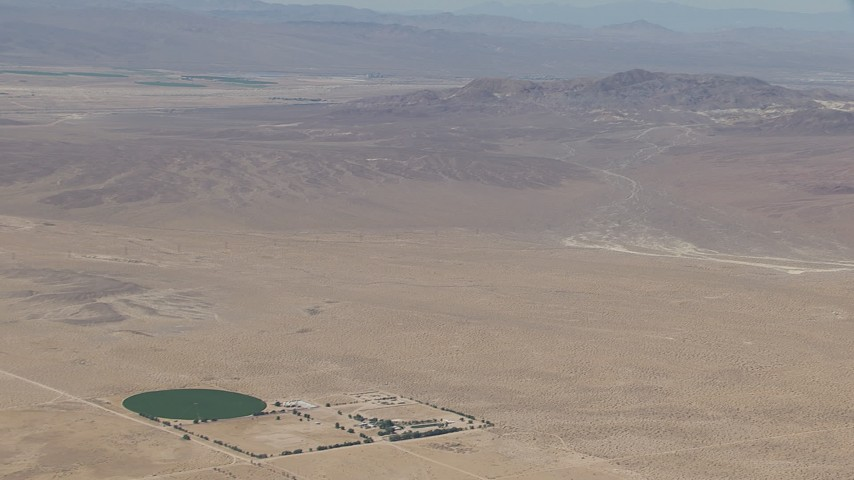 HD stock footage aerial video zoom to a wiper view of a lonely Mojave Desert monastery and crop circle in Newberry Springs, California Aerial Stock Footage | CAP_006_027