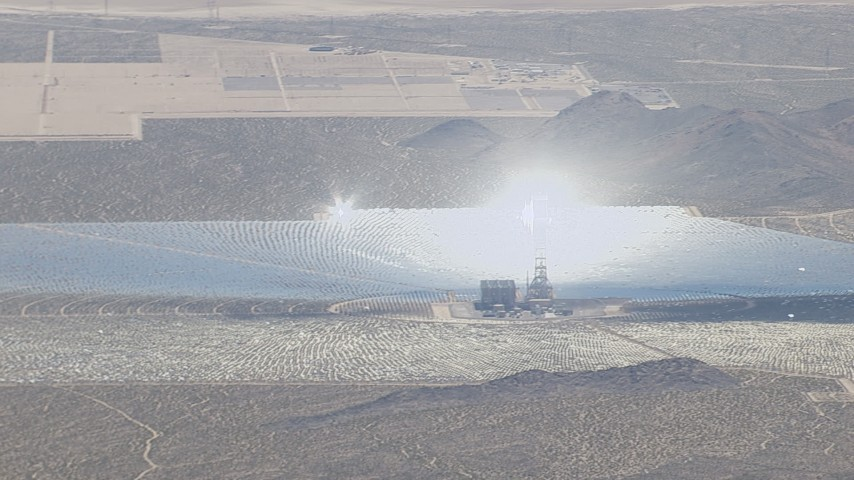 HD stock footage aerial video of glowing boiler atop a power tower at the Ivanpah Solar Electric Generating System in California Aerial Stock Footage | CAP_006_031