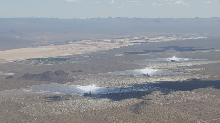 HD stock footage aerial video of passing the Ivanpah Solar Electric Generating System in California with cloud shadow on the arrays Aerial Stock Footage | CAP_006_035