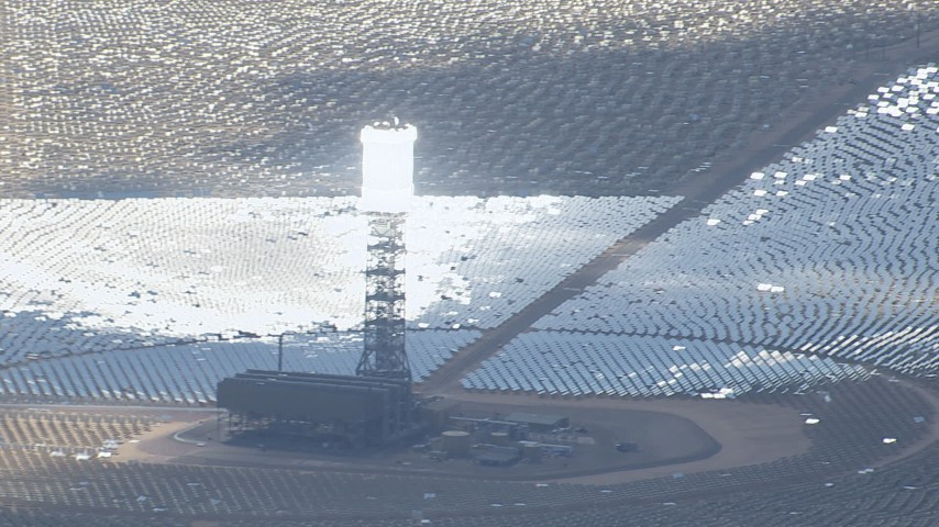 HD stock footage aerial video of power tower with glowing boiler at Ivanpah Solar Electric Generating System in California Aerial Stock Footage | CAP_006_038