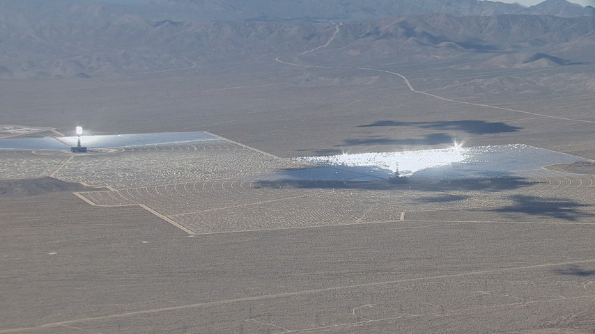 HD stock footage aerial video zoom wider from one of the three solar arrays at Ivanpah Solar Electric Generating System in California Aerial Stock Footage   CAP_006_043