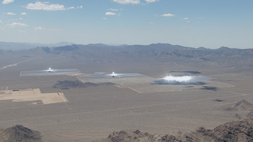 HD stock footage aerial video zoom to a wide view of the three solar arrays, Ivanpah Solar Electric Generating System in California Aerial Stock Footage | CAP_006_044