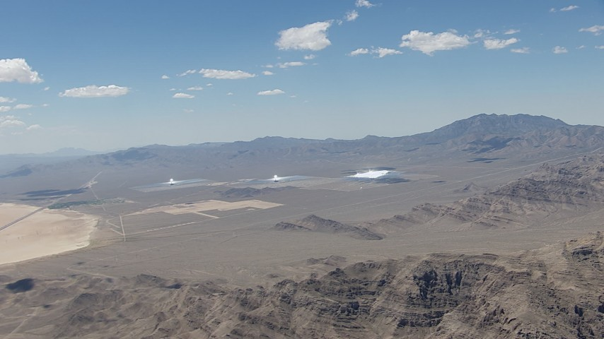 HD stock footage aerial video of a reverse view of the three solar arrays at the Ivanpah Solar Electric Generating System in California Aerial Stock Footage | CAP_006_045