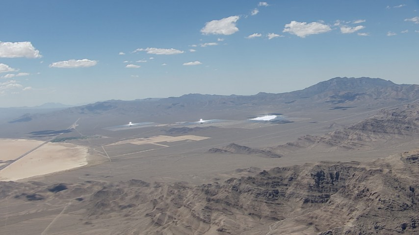 HD stock footage aerial video of flying away from the three solar arrays at Ivanpah Solar Electric Generating System in California Aerial Stock Footage | CAP_006_046