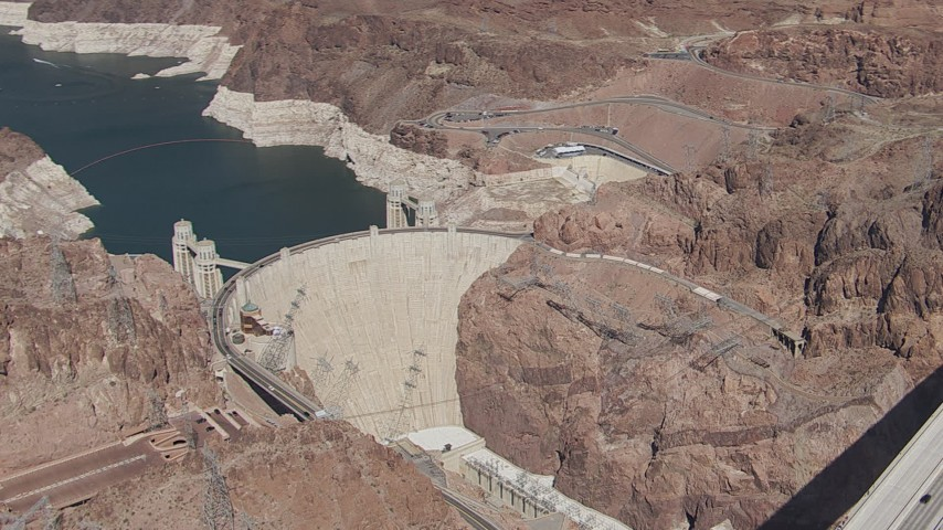 HD stock footage aerial video orbit Hoover Dam as cars cross the top of the structure, Nevada Aerial Stock Footage | CAP_008_005