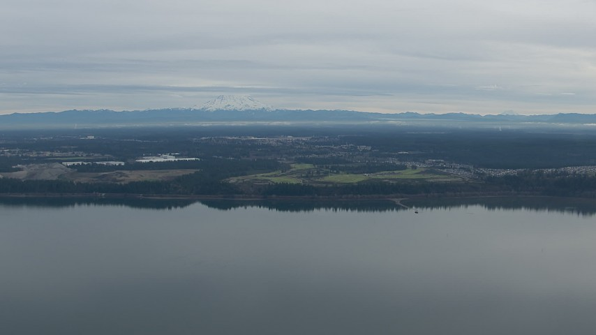 HD stock footage aerial video of Mount Rainier and golf course seen from Puget Sound in DuPont, Washington Aerial Stock Footage | CAP_009_001