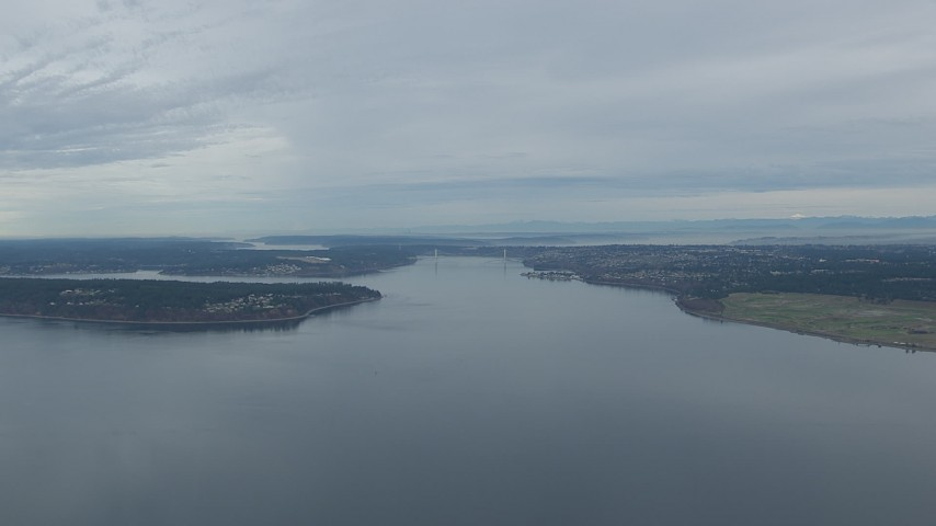 HD stock footage aerial video fly over Puget Sound to approach the Tacoma Narrows Bridge, Washington Aerial Stock Footage | CAP_009_008