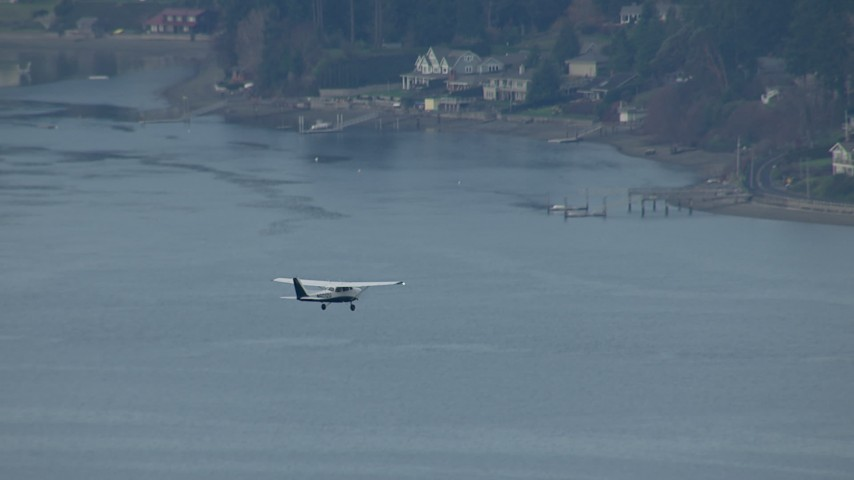 HD stock footage aerial video track an airplane flying over Puget Sound, and reveal waterfront homes, Washington Aerial Stock Footage | CAP_009_011