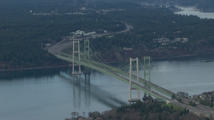 HD stock footage aerial video zoom wider while passing the Tacoma Narrows Bridge spanning Puget Sound, Washington Aerial Stock Footage | CAP_009_013