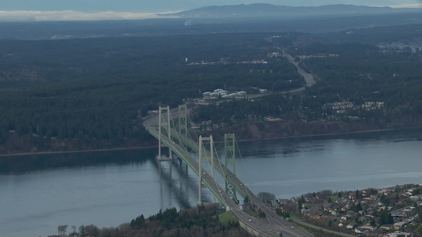HD stock footage aerial video tilt from the Tacoma Narrows Bridge to reveal the Olympic Mountains, Washington Aerial Stock Footage | CAP_009_014