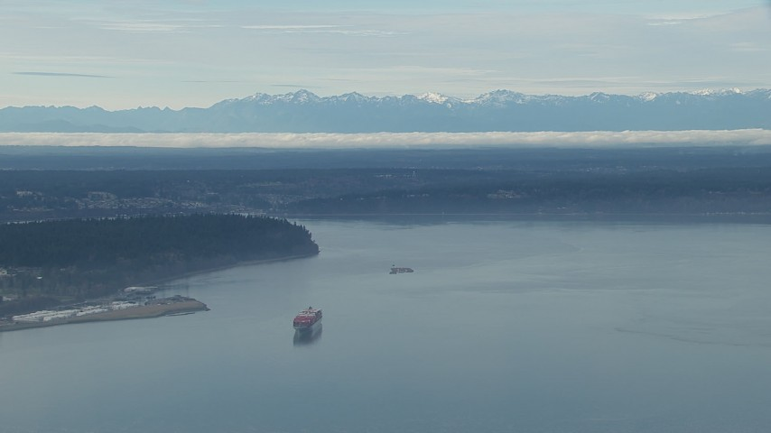 HD stock footage aerial video of a cargo ship sailing Puget Sound and the Olympic Mountains, Washington Aerial Stock Footage | CAP_009_019