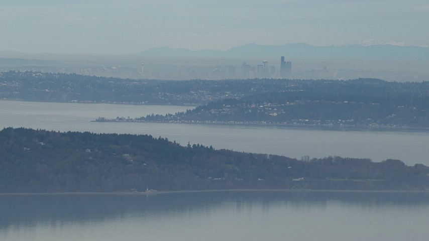 HD stock footage aerial video of the Downtown Seattle skyline seen from Puget Sound, Washington Aerial Stock Footage | CAP_009_023