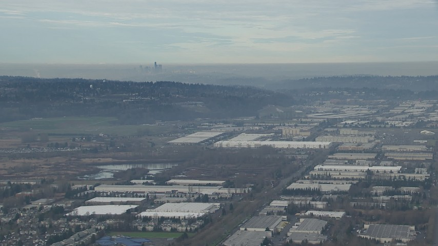 HD stock footage aerial video of the Downtown Seattle skyline seen from warehouse buildings in Kent, Washington Aerial Stock Footage | CAP_009_032