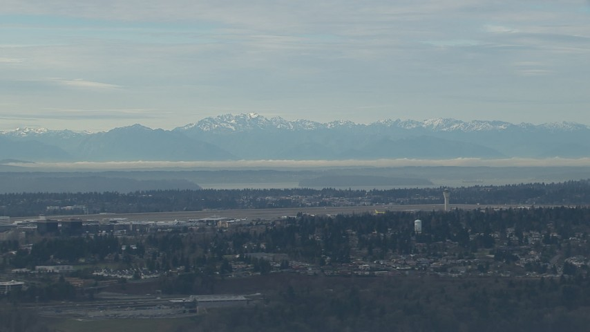 HD stock footage aerial video of the Olympic Mountains seen from the Seattle Tacoma Airport, Washington Aerial Stock Footage | CAP_009_034