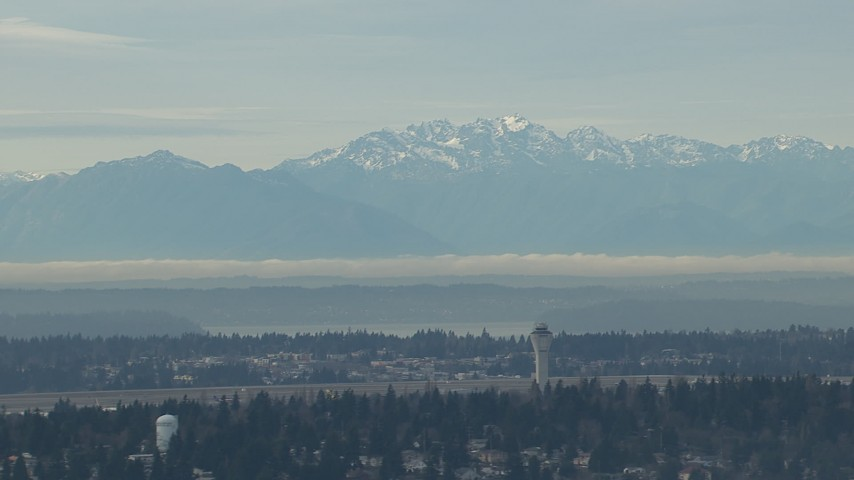 HD stock footage aerial video of the Olympic Mountains and the Seattle Tacoma Airport control tower, Washington Aerial Stock Footage | CAP_009_035