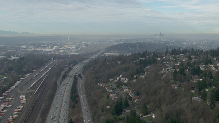 HD stock footage aerial video of Downtown Seattle skyline seen while following I-5 to Boeing Field, Washington Aerial Stock Footage | CAP_009_038