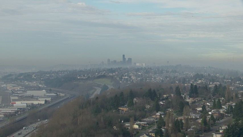 HD stock footage aerial video of Downtown Seattle skyline seen from hillside homes and I-5, Washington Aerial Stock Footage | CAP_009_040