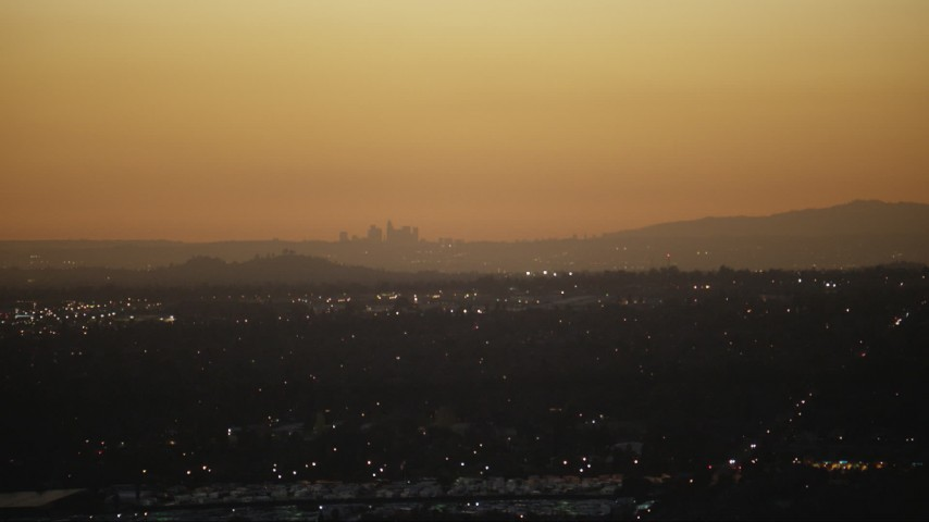 HD stock footage aerial video of the Downtown Los Angeles skyline at twilight seen from homes in the San Gabriel Valley, California Aerial Stock Footage | CAP_010_002