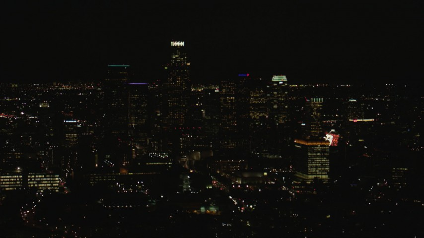 HD stock footage aerial video flyby the Downtown Los Angeles city skyline at night, California Aerial Stock Footage | CAP_010_013