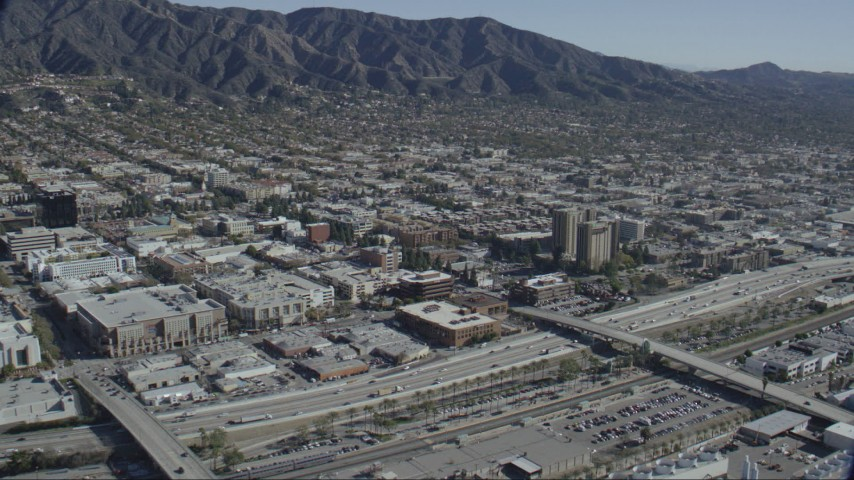 HD stock footage aerial video of Burbank Town Center, office buildings and hotel in Burbank, California Aerial Stock Footage | CAP_012_003
