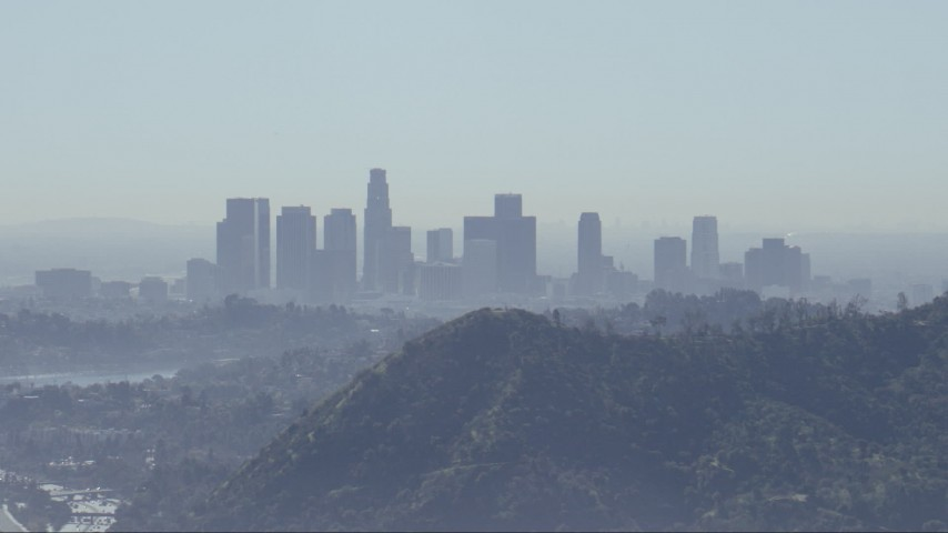 HD stock footage aerial video of a view of the Downtown Los Angeles skyline, reveal Silver Lake Reservoir, California Aerial Stock Footage | CAP_012_005