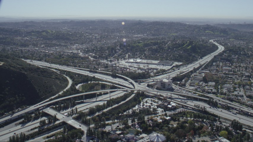 HD stock footage aerial video of the 2 and 134 freeway interchange in Glendale, California Aerial Stock Footage | CAP_012_010