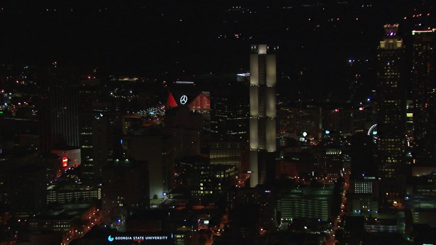 HD stock footage aerial video flyby skyscrapers to reveal Mercedes Benz Stadium at night, Downtown Atlanta, Georgia Aerial Stock Footage | CAP_013_006