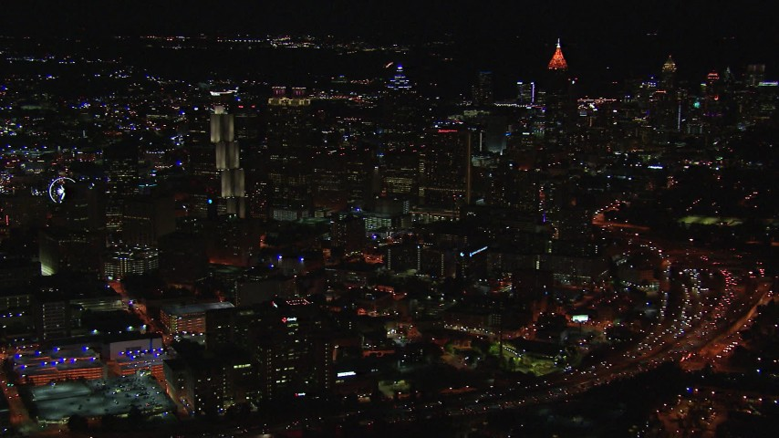 HD stock footage aerial video of orbiting skyscrapers and city buildings at night, Downtown and Midtown Atlanta, Georgia Aerial Stock Footage | CAP_013_009