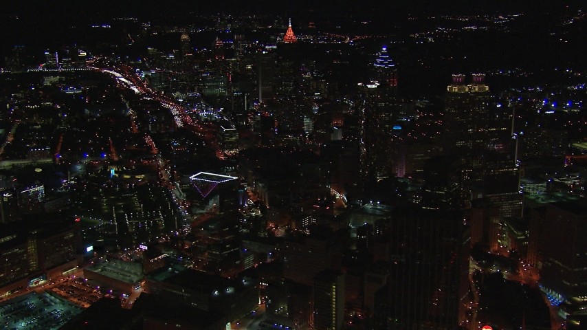 HD stock footage aerial video of flying by skyscrapers and city buildings at night, Downtown and Midtown Atlanta, Georgia Aerial Stock Footage | CAP_013_011