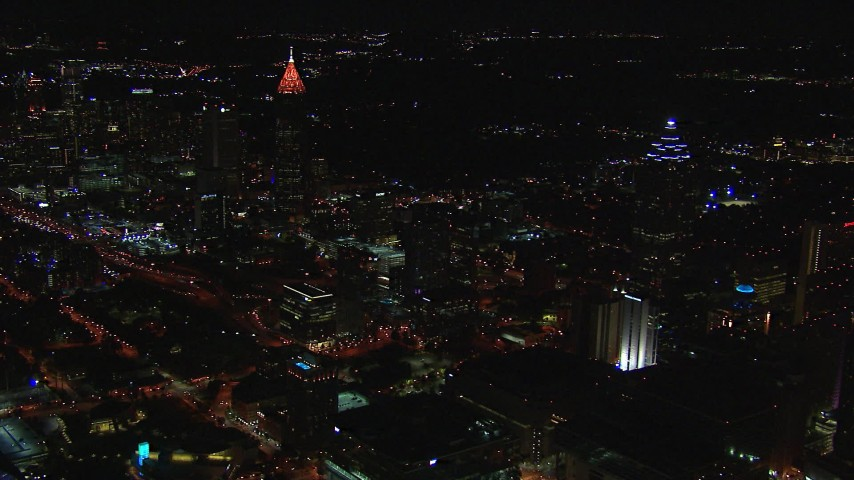 HD stock footage aerial video of flying by tall skyscrapers at night, Downtown and Midtown Atlanta, Georgia Aerial Stock Footage | CAP_013_012