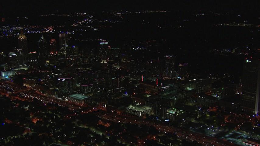 HD stock footage aerial video of flying by office buildings at night, Midtown Atlanta, Georgia Aerial Stock Footage   CAP_013_014