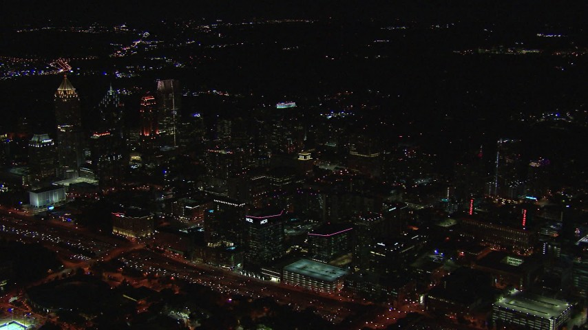 HD stock footage aerial video of passing by office buildings and skyscrapers at night, Midtown Atlanta, Georgia Aerial Stock Footage   CAP_013_015