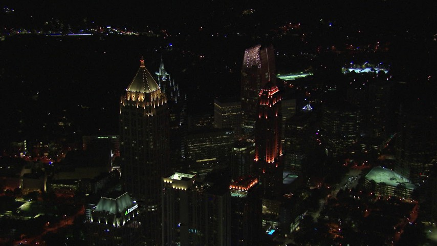 HD stock footage aerial video approach skyscraper and hotel at night, Midtown Atlanta, Georgia Aerial Stock Footage   CAP_013_016