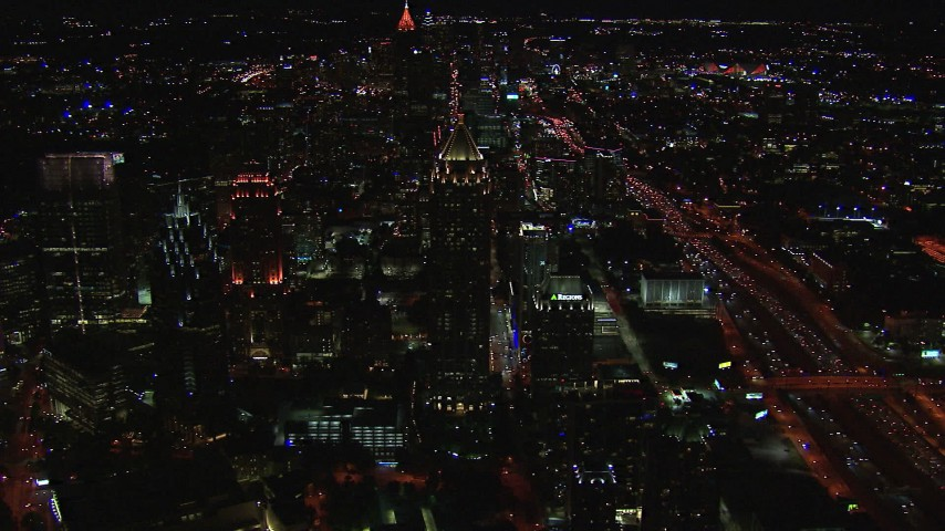 HD stock footage aerial video flying away from One Atlantic Center at night, Midtown Atlanta, Georgia Aerial Stock Footage   CAP_013_018