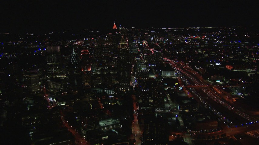 HD stock footage aerial video flying away from city buildings and skyscrapers at night, Midtown Atlanta, Georgia Aerial Stock Footage | CAP_013_019