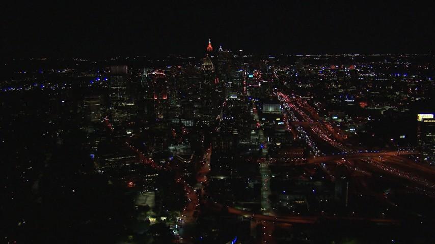 HD stock footage aerial video wide reverse view of city buildings and skyscrapers at night, Midtown Atlanta, Georgia Aerial Stock Footage | CAP_013_020