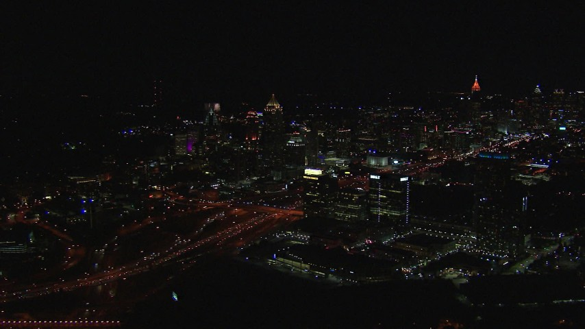 HD stock footage aerial video of passing by city buildings and skyscrapers at night, Midtown Atlanta, Georgia Aerial Stock Footage | CAP_013_021