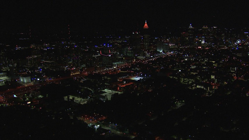 HD stock footage aerial video of passing by city buildings and skyscrapers at night, Midtown and Downtown Atlanta, Georgia Aerial Stock Footage | CAP_013_022