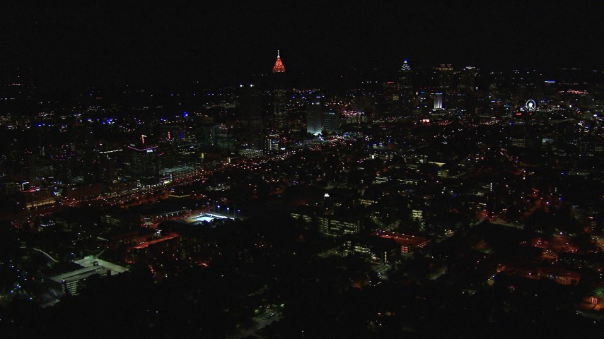 HD stock footage aerial video of flying past city buildings and skyscrapers at night, Midtown and Downtown Atlanta, Georgia Aerial Stock Footage | CAP_013_023