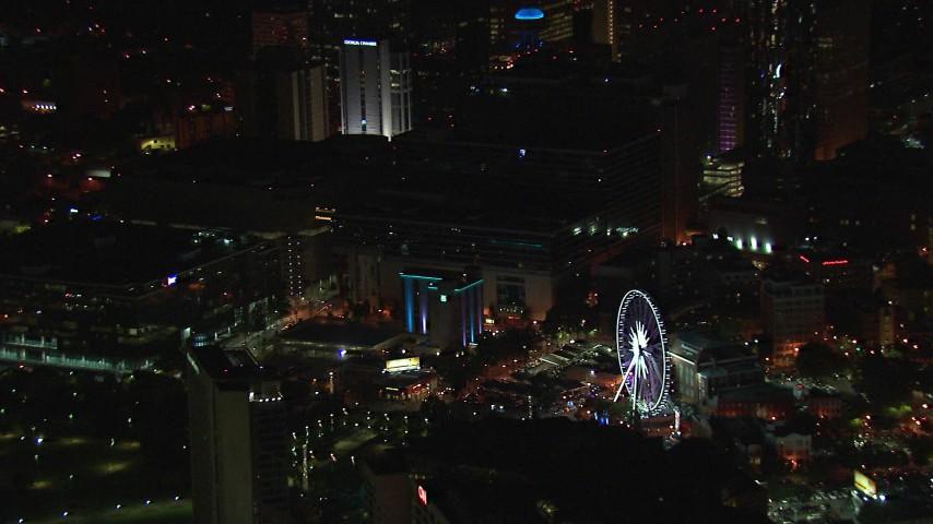 HD stock footage aerial video of orbiting city buildings and Ferris wheel at night, Downtown Atlanta, Georgia Aerial Stock Footage | CAP_013_027