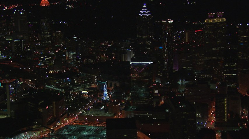 HD stock footage aerial video of flying away from city buildings and skyscrapers near Ferris wheel at night, Downtown Atlanta, Georgia Aerial Stock Footage | CAP_013_028