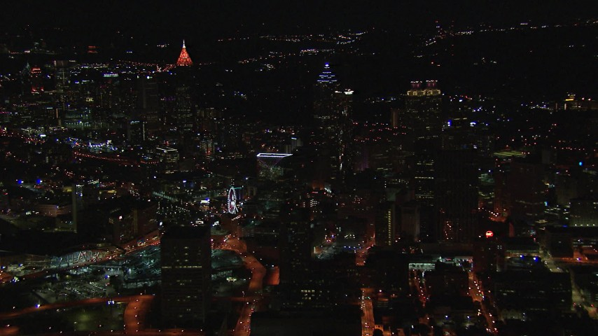 HD stock footage aerial video of flying away from city buildings and skyscrapers at night, Downtown Atlanta, Georgia Aerial Stock Footage | CAP_013_029