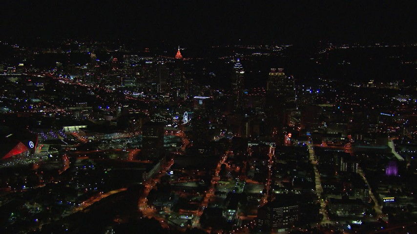 HD stock footage aerial video reverse view of city buildings and skyscrapers at night, Downtown Atlanta, Georgia Aerial Stock Footage | CAP_013_030