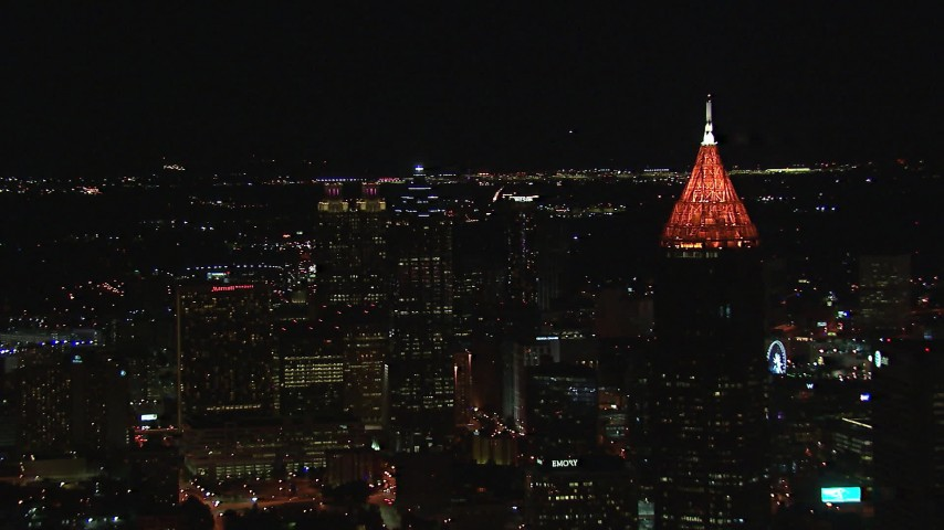 HD stock footage aerial video reverse view of SunTrust Plaza and Bank of America Plaza at night, Downtown Atlanta, Georgia Aerial Stock Footage | CAP_013_036