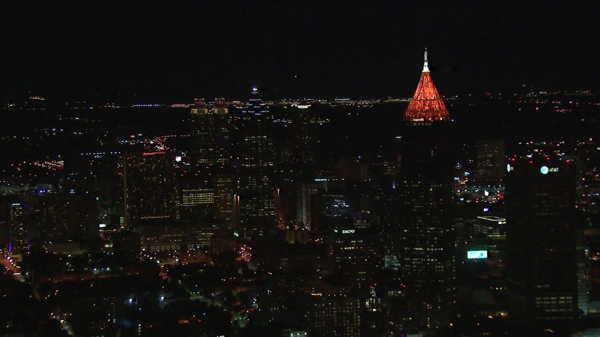 HD stock footage aerial video of downtown skyscrapers and Bank of America Plaza at night, Midtown Atlanta, Georgia Aerial Stock Footage   CAP_013_037