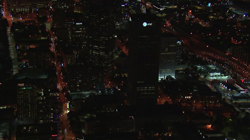 HD stock footage aerial video of AT&T Center skyscraper at night, Midtown Atlanta, Georgia Aerial Stock Footage | CAP_013_038
